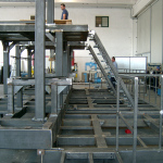 pre-assembly in the workshop of a support structure for weighing and packaging system